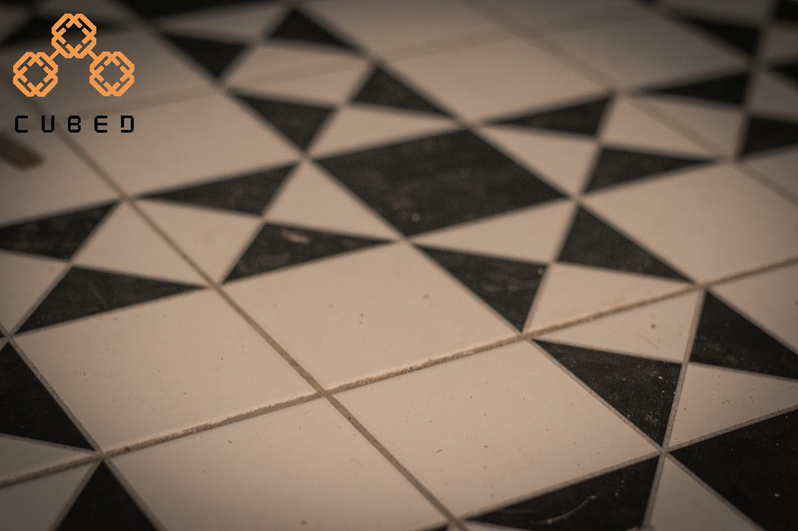 A blurry photograph of designer tiled flooring at cubed cuts and coffee for the Starting a business from scratch podcast