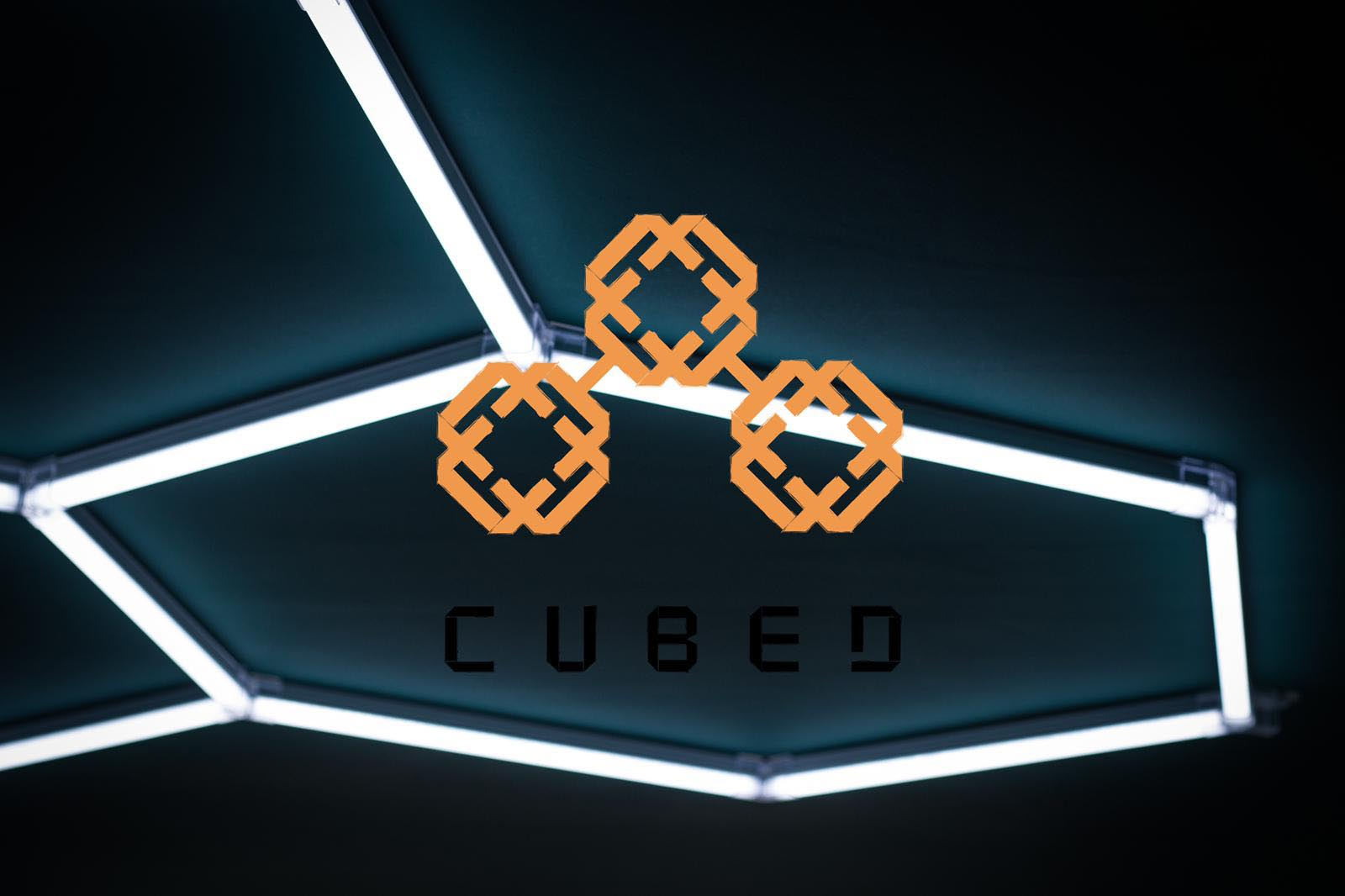 Starting a business from scratch podcast image. Cubed Cuts and coffee logo overlaid on a hexagonal light feature in the shop.